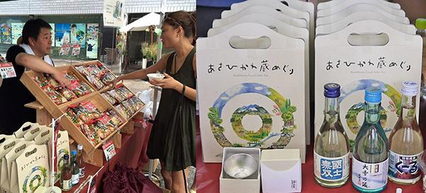 ▲道の駅あさひかわの黄野俊幸さん(左)。「旭川の蔵元3社の地酒セット」には旭川の職人が鋳物の技で磨き上げた錫100%のぐいのみ付き